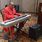 Keyboardist at Senior Holiday Luncheon.
